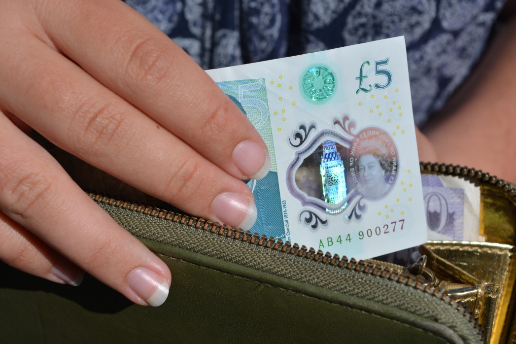 https://watt.co.uk/wp-content/uploads/2019/12/young-woman-taking-a-british-5-note-from-her-wallet_t20_ko3y64.jpg
