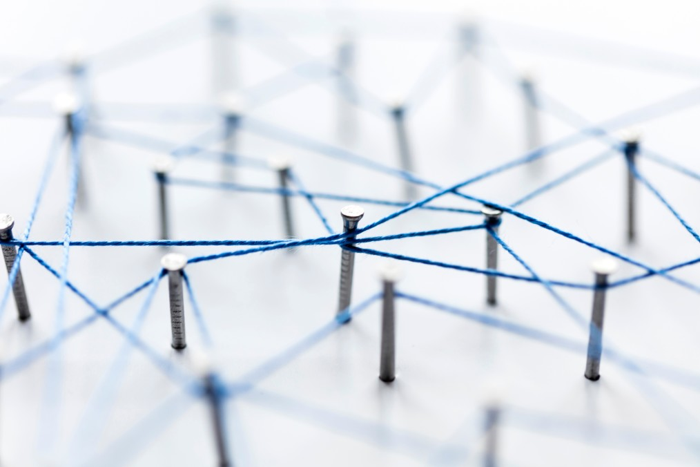 pins connected by a blue string