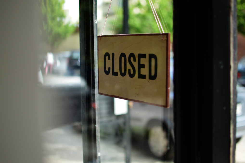 closed sign up on a shop door