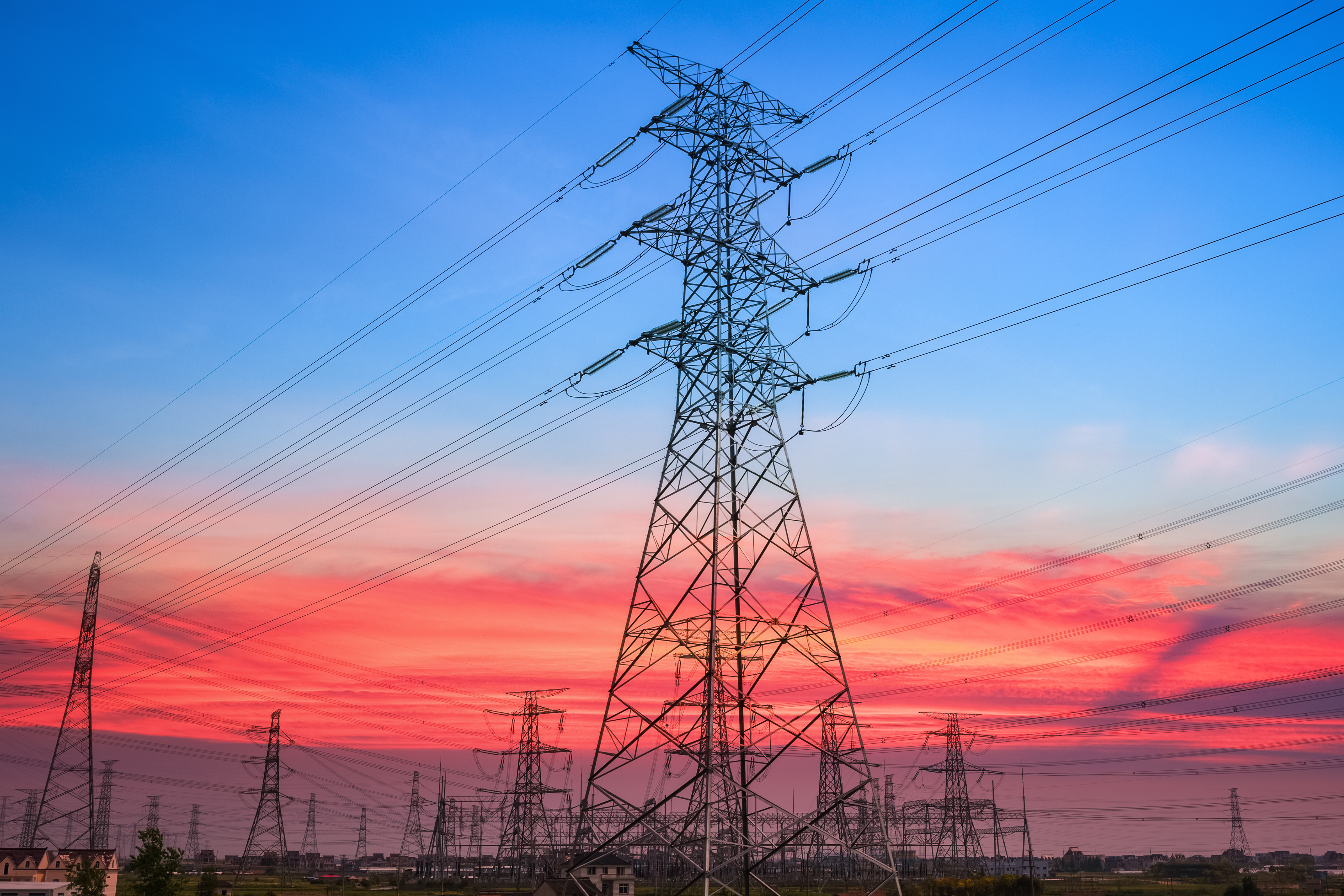 https://watt.co.uk/wp-content/uploads/2020/04/electricity-pylon-in-sunset-PFED56H.jpg