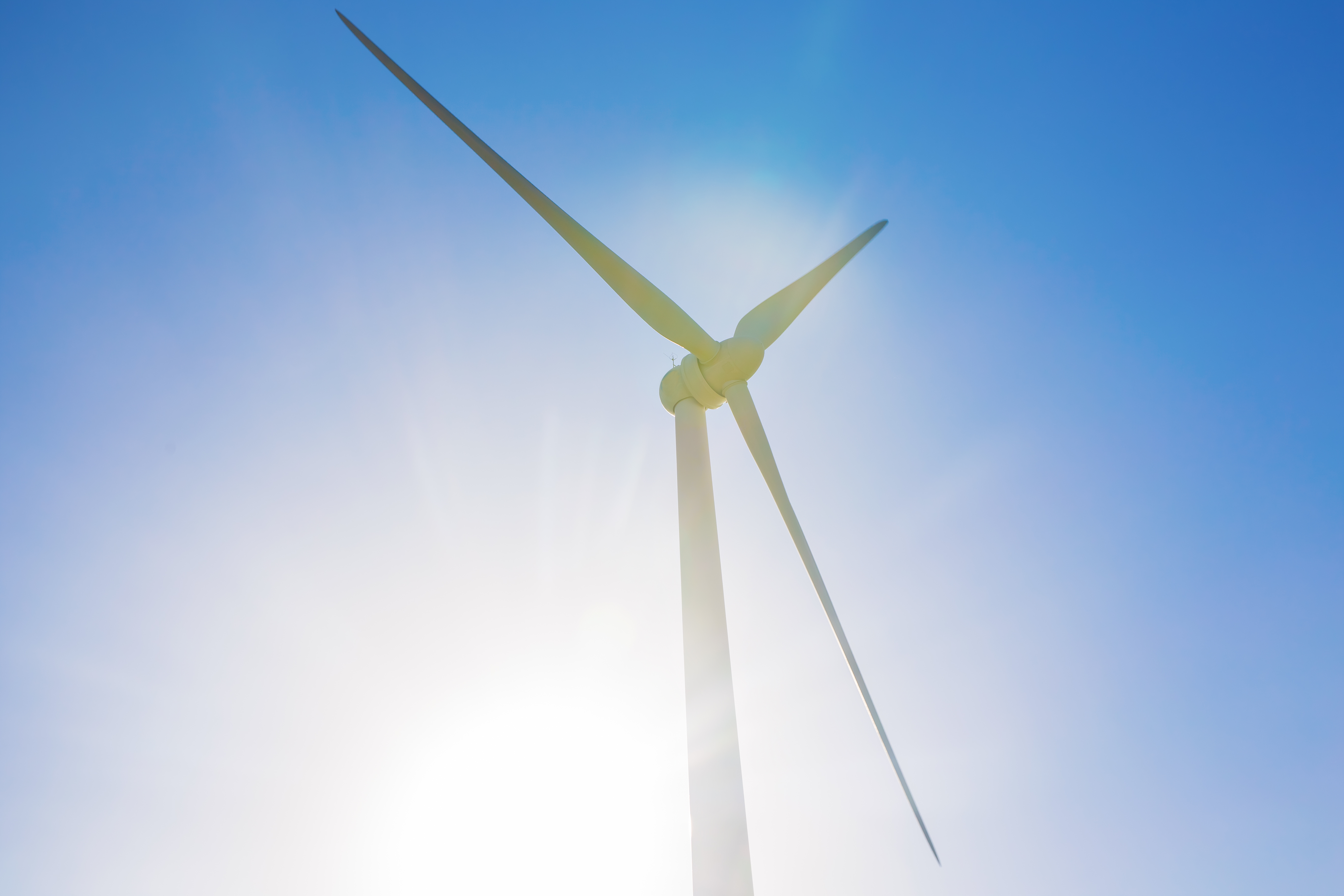 https://watt.co.uk/wp-content/uploads/2020/04/powerful-and-ecological-energy-concept-windmill-fo-PYLKRPD.jpg