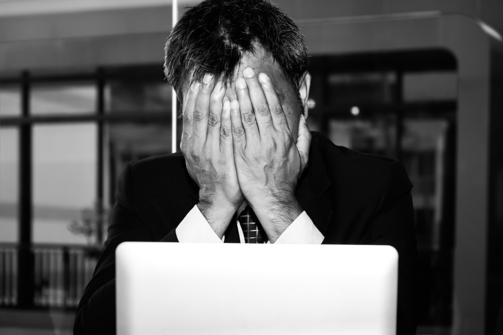 an-asian-male-businessman-is-sad-and-crying-in-front-of-the-computer-laptop-for-his-failure
