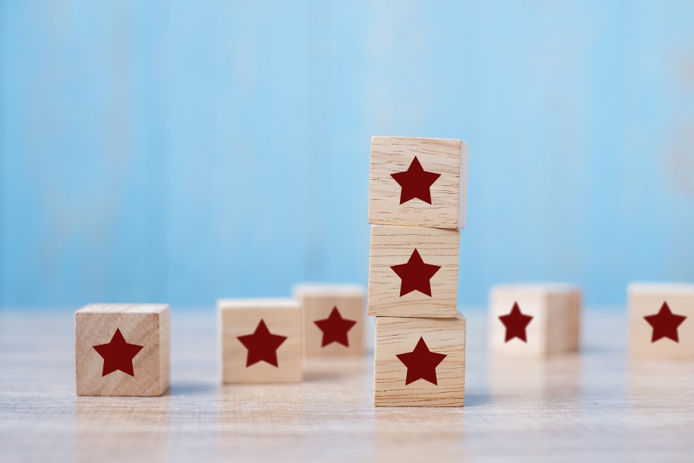 customer-holding-wooden-blocks-with-the-star-symbol-customer-reviews-feedback-rating-ranking