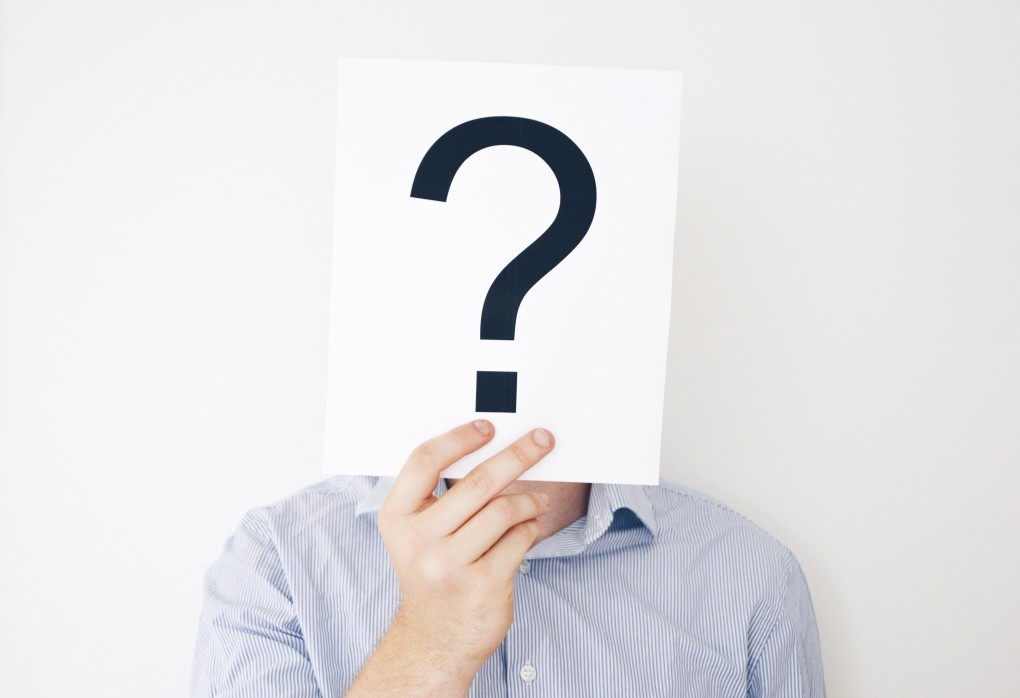 https://watt.co.uk/wp-content/uploads/2020/07/nominated-man-holding-a-question-mark-in-front-of-his-face-sold-psychology-unsure-ask-shirt-paper-guy_t20_P366dB.jpg