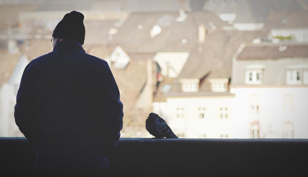 older man on rooftop in winter