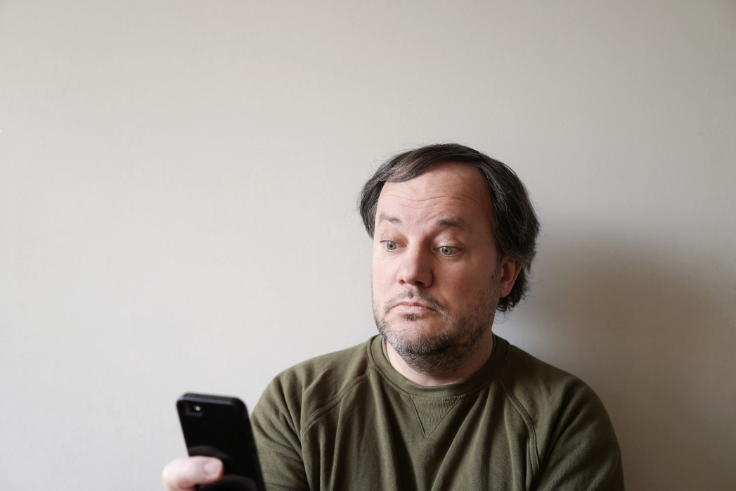 https://watt.co.uk/wp-content/uploads/2020/08/wide-eyed-man-looking-at-smartphone-sitting-by-wall-with-copy-space_t20_OzYEbg.jpg
