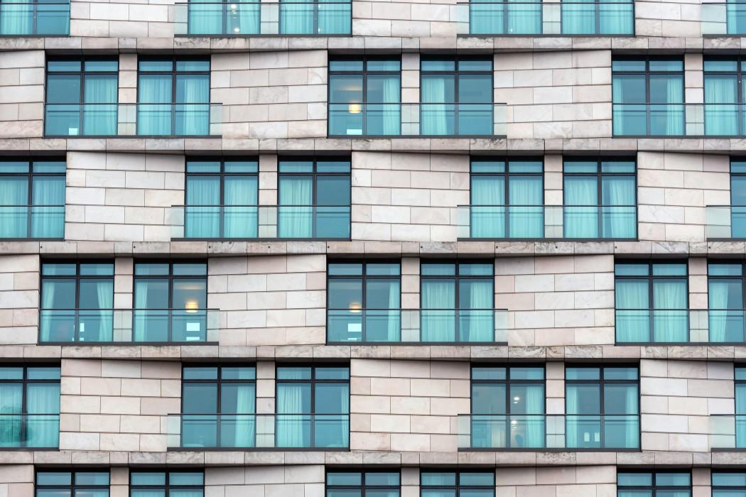 https://watt.co.uk/wp-content/uploads/2020/09/close-up-of-the-facade-of-a-modern-high-rise-stone-building-facade-building-stone-modern-architecture_t20_KvrzRZ.jpg